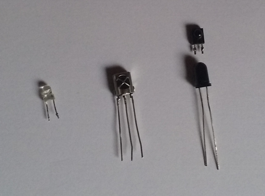 From left to right: A 3mm IR LED, a VS 1383B receiver and 2 photodiodes